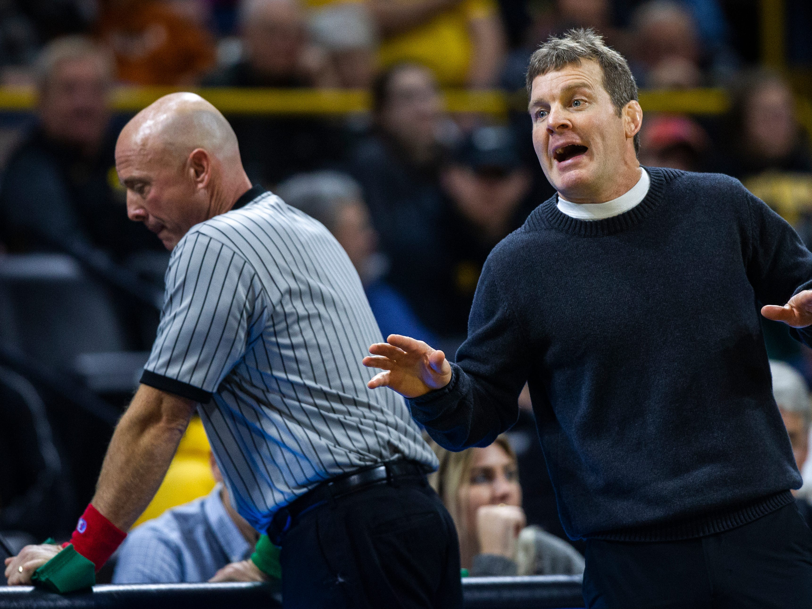 Iowa head coach Tom Brands calls out to an official while calling a challenge during an NCAA wrestle dual on Friday, Nov. 16, 2018, at Carver-Hawkeye Arena in Iowa City.