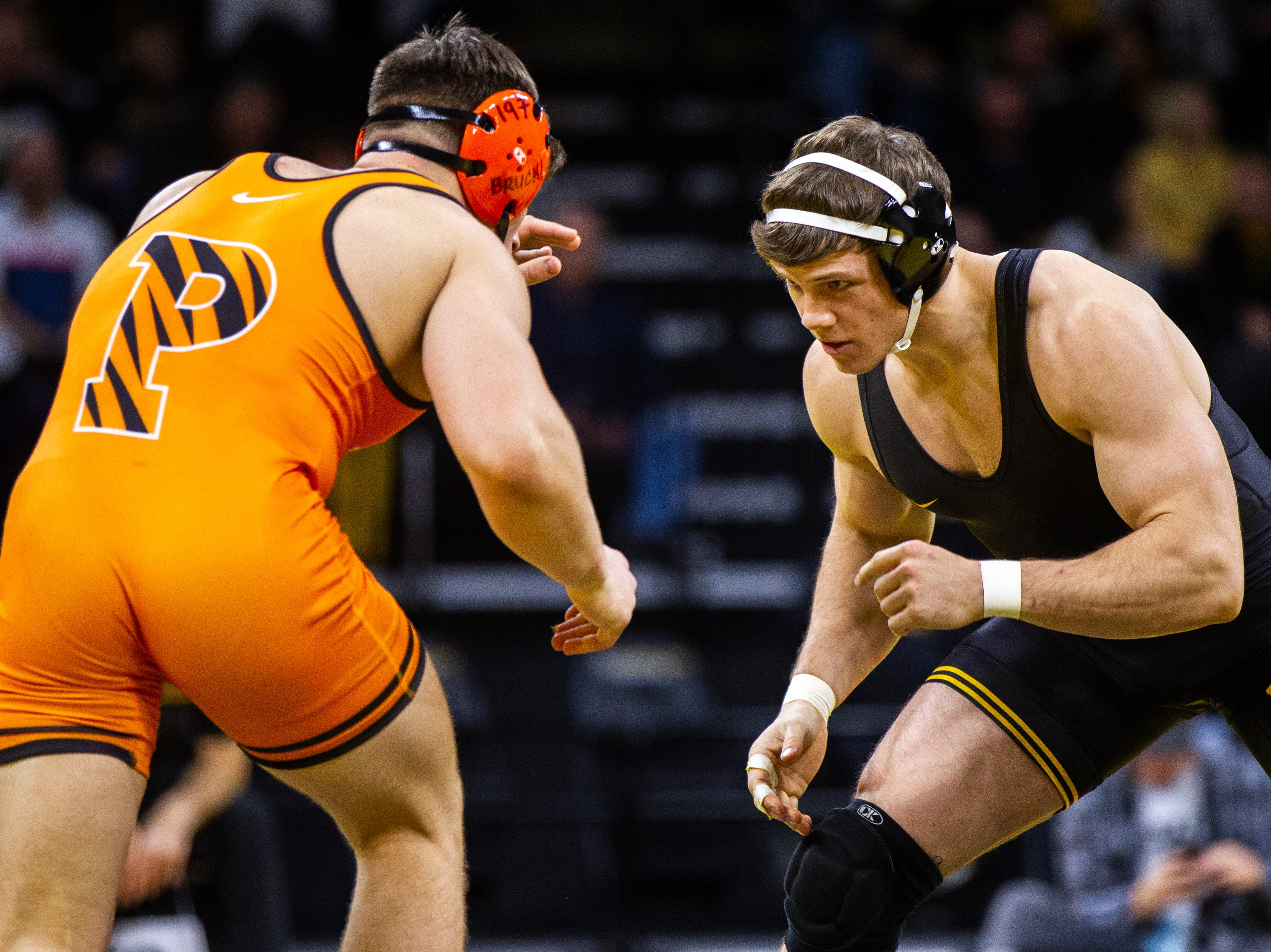 Iowa's Connor Corbin (right) wrestles Princeton's Patrick Brucki at 197 during an NCAA wrestle dual on Friday, Nov. 16, 2018, at Carver-Hawkeye Arena in Iowa City.