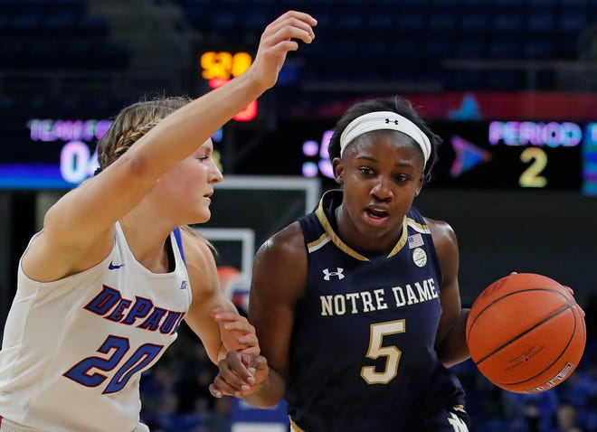 Notre Dame's Jackie Young, right, is guarded by DePaul's Kelly Campbell during the first half of an NCAA college basketball game Saturday, Nov. 17, 2018, in Chicago.