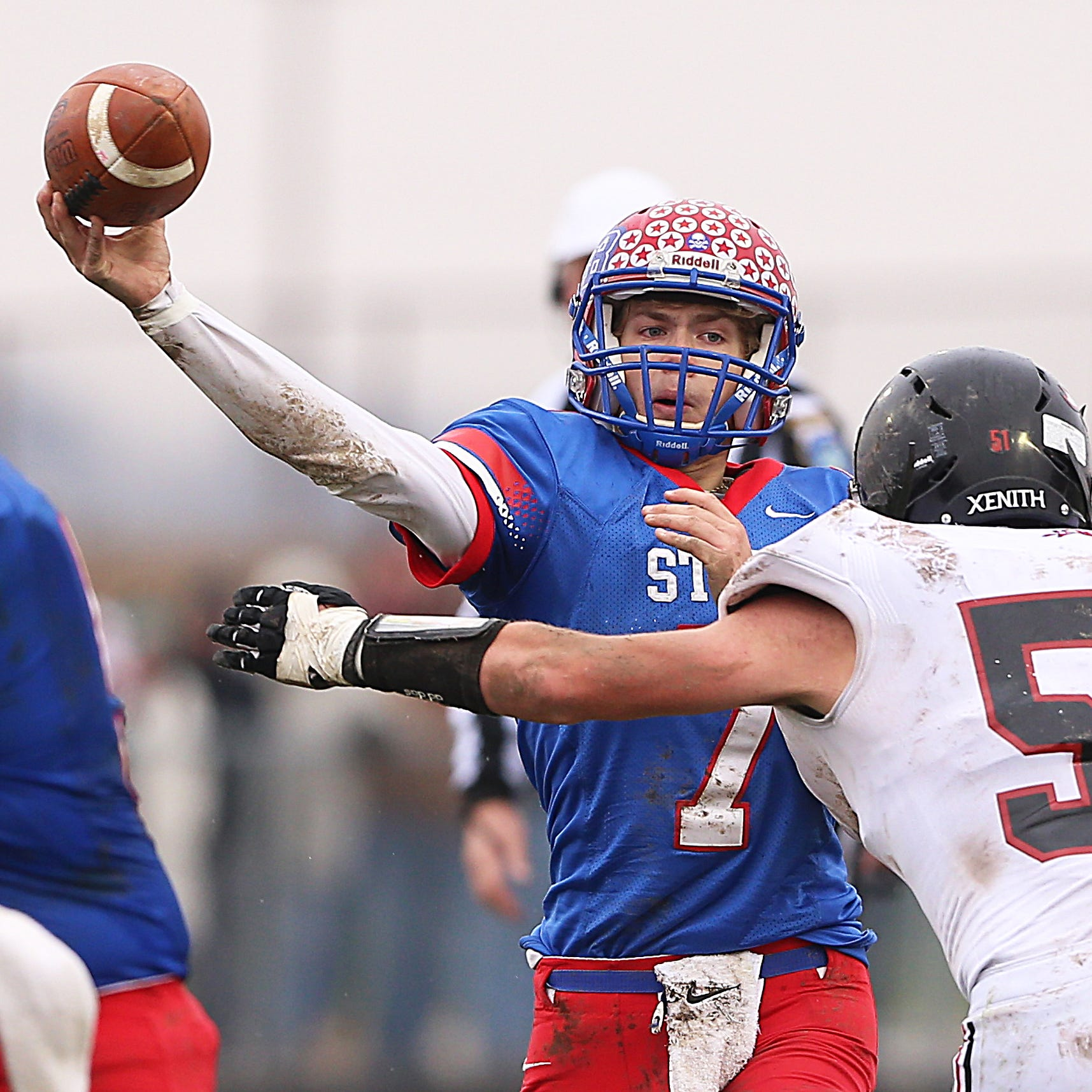 Western Boone Star Spencer Wright (7) gets the ball out the pocket against Southridge Raider Conner Oxley (51) in the second half of the IHSAA Class 2A semi-state final game at Western Boone High School in Thorntown, Ind., Saturday, Nov. 17, 2018. Western Boone defeated Southridge 48-7.