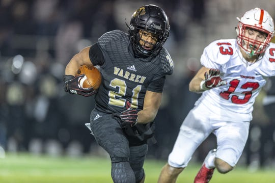 Warren Central  senior Romeir Elliott ran wild against Center Grove on Friday night.