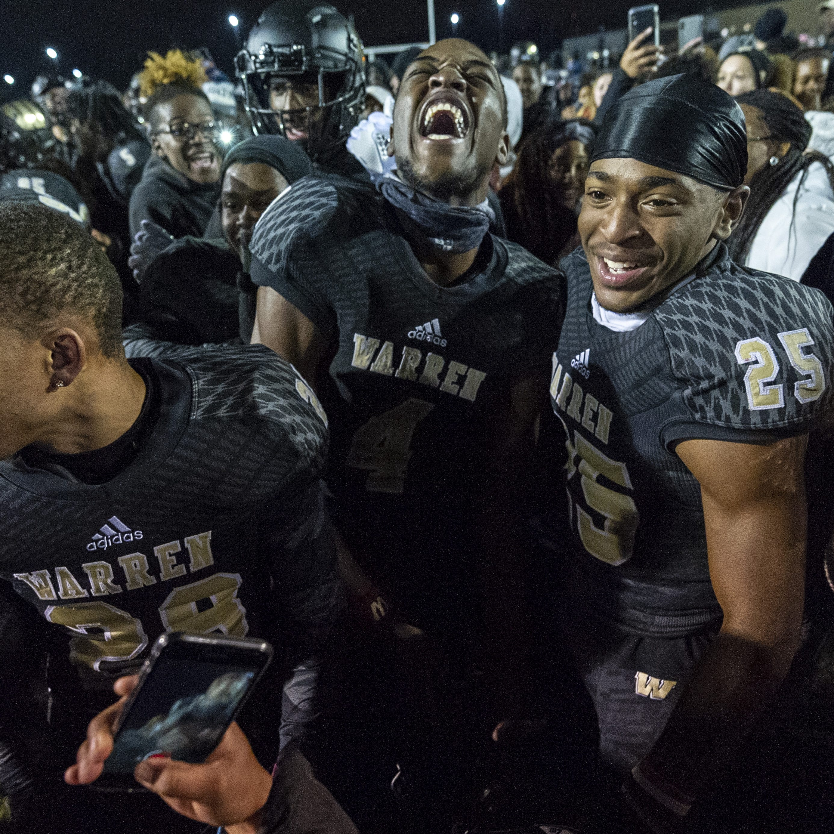 Warren Central High School junior Randy Wells Jr. (29), from left, senior David Bell (4) , and sophomore Damon Cassie (25) celebrate their win after the game. Warren Central High School hosted Center Grove High School in an IHSAA Class 6A Semi-State varsity football game, Friday, Nov. 16, 2018. Warren Central won 27-20.