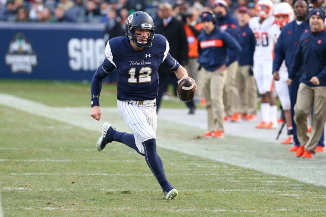 Notre Dame Fighting Irish quarterback Ian Book (12) runs with the ball against the Syracuse Orange during the second quarter at Yankee Stadium.