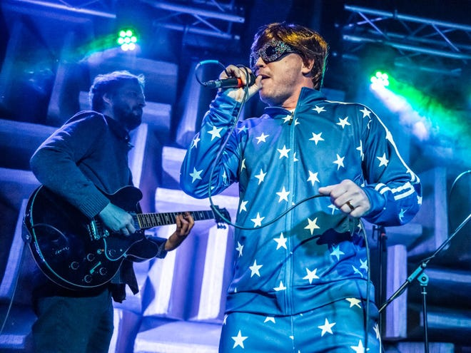 Former Tonic Ball chairman Matt Mays portrays Elton John while performing with the band Rooms Friday at the Hi-Fi.