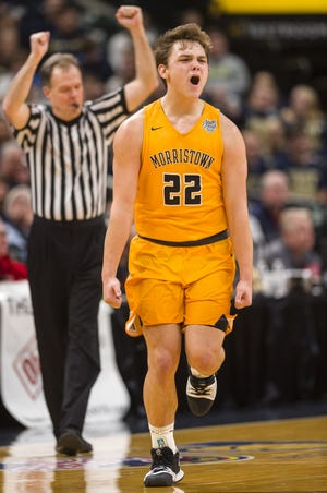 Morristown guard Logan Laster (22) reacts after hitting a 3-pointer during the first half of the IHSAA Boys' Basketball Class A State Finals game at Bankers Life Fieldhouse,, March 24, 2018.