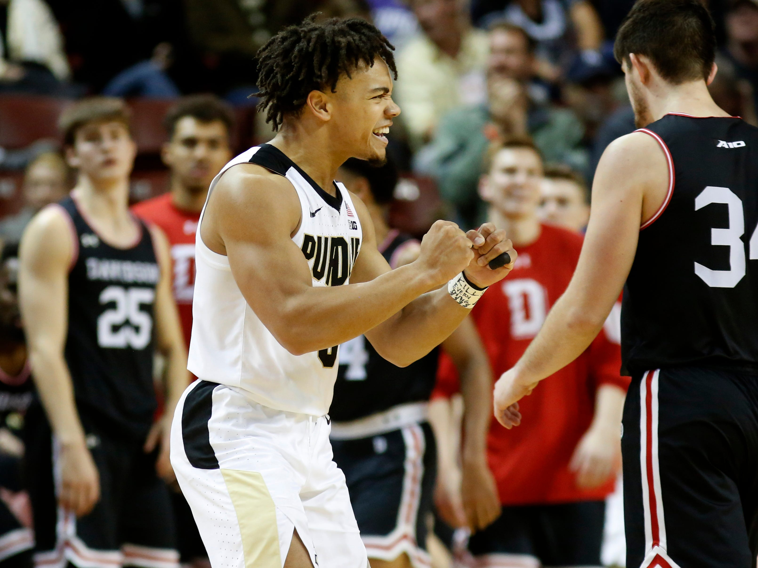 Purdue's Carsen Edwards reacts afte his team started pulling away from Davidson in the second half of an NCAA college basketball game at the Charleston Classic at TD Arena, Friday, Nov. 16, 2018, in Charleston, S.C. (AP Photo/Mic Smith)