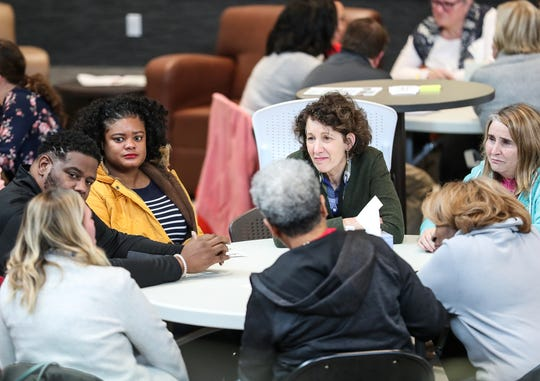 Participants hold small group discussions during a community forum held by Noblesville Diversity Coalition at Ivy Tech Community College in Noblesville, Ind., Saturday, Nov. 17, 2018. Participants at the forum discussed a recent racially-charged threat left in a Noblesville High School bathroom and other safety concerns.