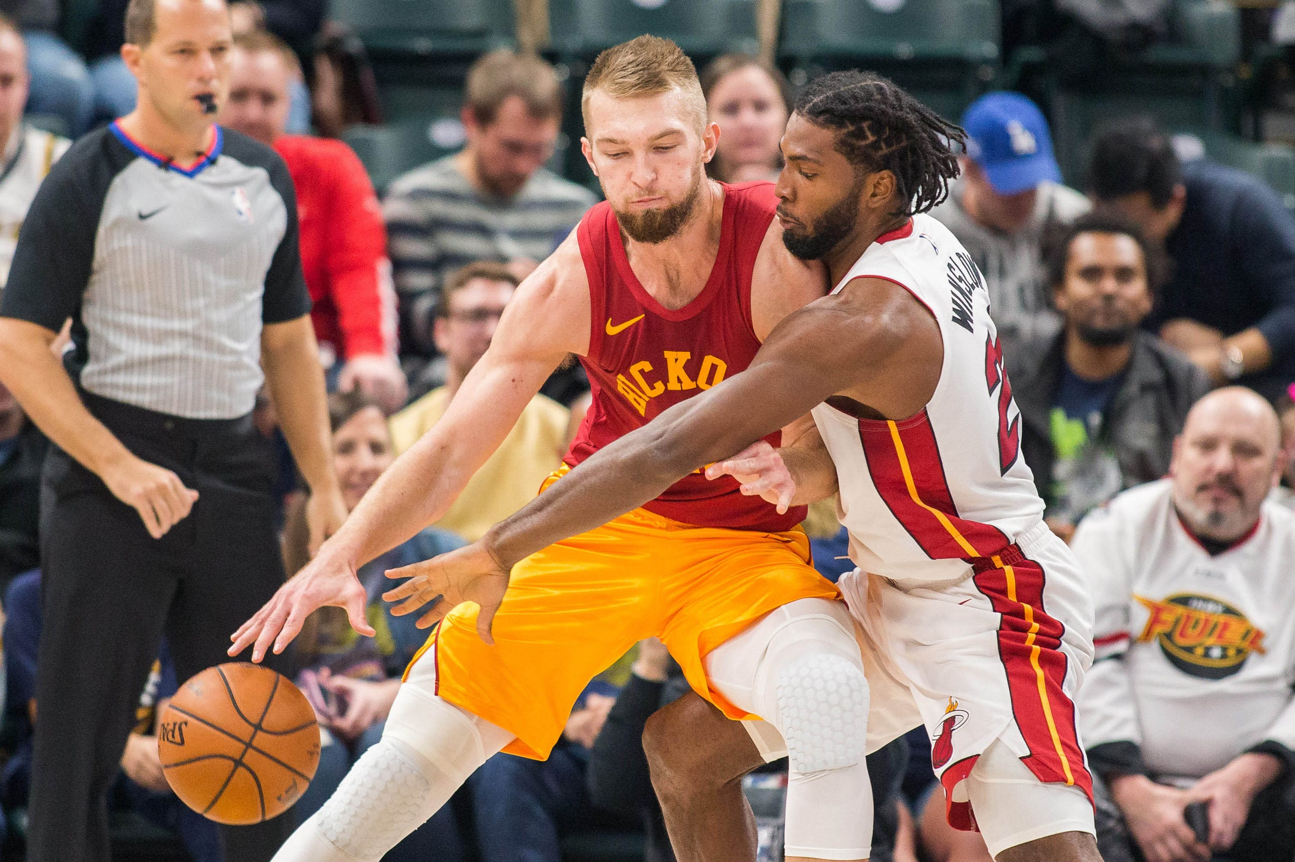45664e9ecea Indiana Pacers forward Domantas Sabonis (11) dribbles the ball against  Miami Heat forward Justise