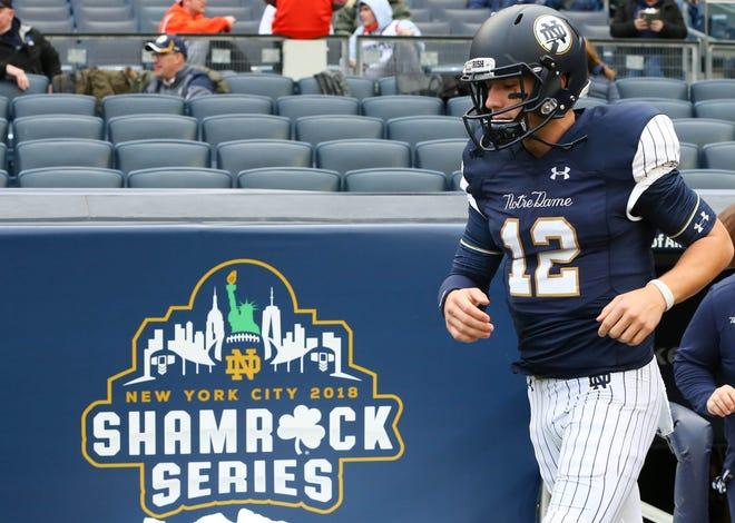 Nov 17, 2018; New York, NY, USA; Notre Dame Fighting Irish quarterback Ian Book (12) walks on the field prior to the game against the Syracuse Orange at Yankee Stadium. Mandatory Credit: Rich Barnes-USA TODAY Sports