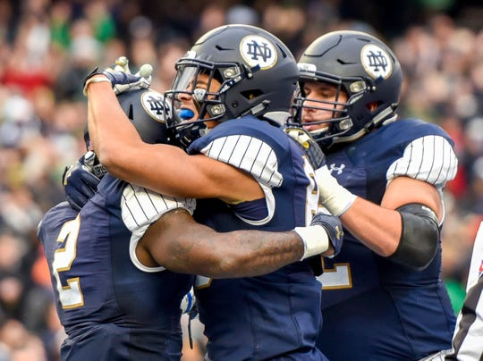 Notre Dame running back Dexter Williams (2) celebrates  with teammates after scoring in the first half of an NCAA college football game against Syracuse, Saturday, Nov. 14, 2018, at Yankee Stadium in New York.
