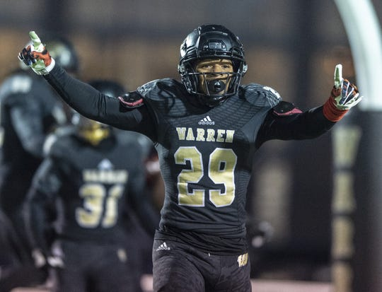 Warren Central High School junior Randy Wells Jr. (29) reacts to the Warriors scoring off of a Center Grove fumble during the first half of action. Warren Central High School hosted Center Grove High School in an IHSAA Class 6A Semi-State varsity football game, Friday, Nov. 16, 2018.