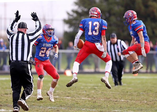 Western Boone Star Logan Benson (13) celebrates an interception with his teammate against the Southridge Raiders in the first half of the IHSAA Class 2A semi-state final game at Western Boone High School in Thorntown, Ind., Saturday, Nov. 17, 2018. Western Boone defeated Southridge 48-7.