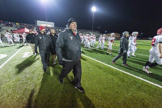 Center Grove High School head coach Eric Moore walks across the field after team's loss. Warren Central High School hosted Center Grove High School in an IHSAA Class 6A Semi-State varsity football game, Friday, Nov. 16, 2018. Warren Central won 27-20.