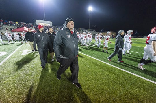 Center Grove High School head coach Eric Moore walks across the field after team's loss. Warren Central High School hosted Center Grove High School in an IHSAA Class 6A Semi-State varsity football game, Friday, Nov. 16, 2018. Warren Central won 27-20.