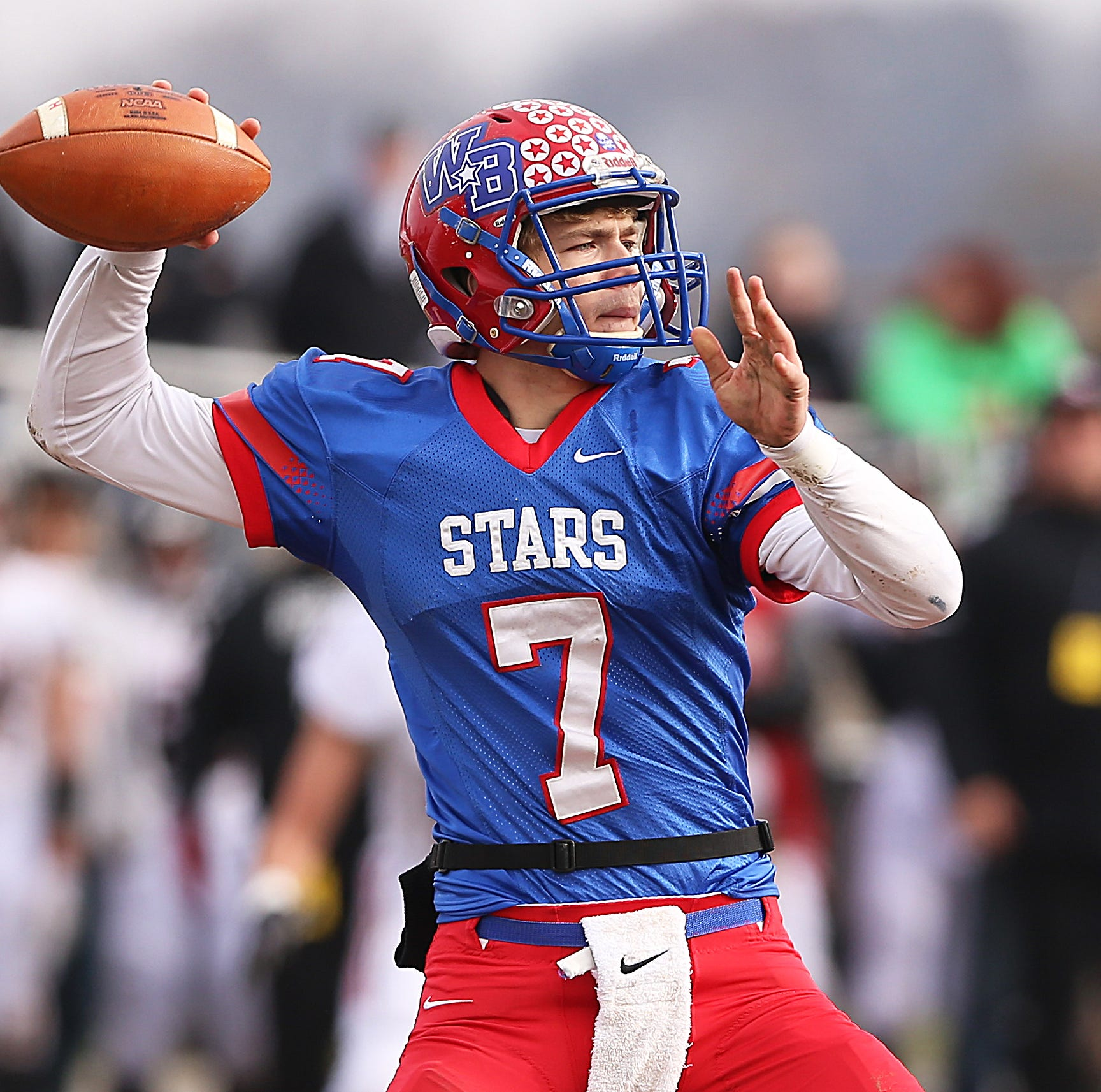 Western Boone Star Spencer Wright (7) looks to throw the ball against the Southridge Raiders in the first half of the IHSAA Class 2A semi-state final game at Western Boone High School in Thorntown, Ind., Saturday, Nov. 17, 2018. Western Boone defeated Southridge 48-7.
