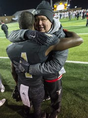 Warren Central senior David Bell (4) walked across the field to greet Center Grove coach Eric Moore after the game.