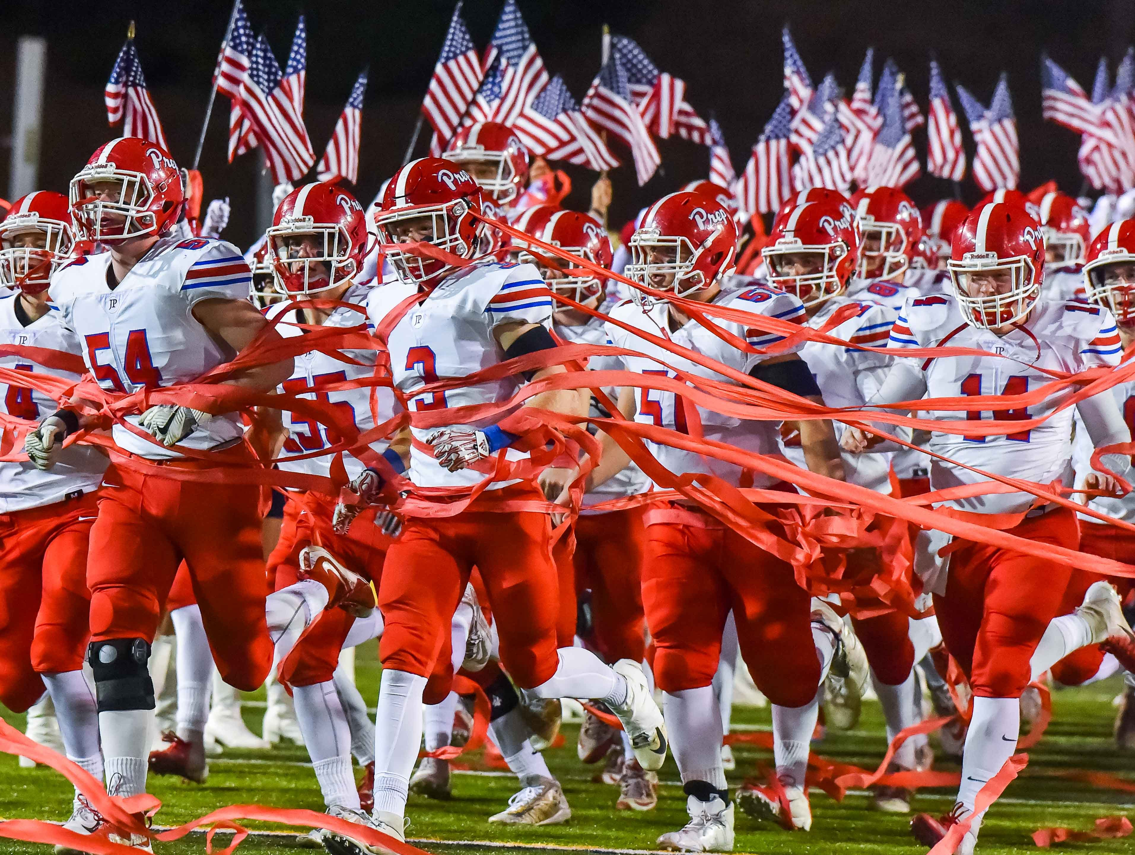 Jackson Prep players enter the field before the MAIS Class AAAA Championship Football game held at Jackson Academy in Jackson, MS, Thursday November 16, 2018.(Bob Smith-For The Clarion Ledger)