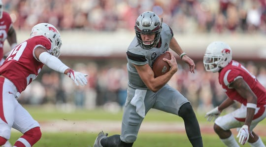 Mississippi State's Nick Fitzgerald (7) braces for a hit near the goal line in the second half. Mississippi State played Arkansas in an SEC football game on Saturday, November 17, 2018. Photo by Keith Warren