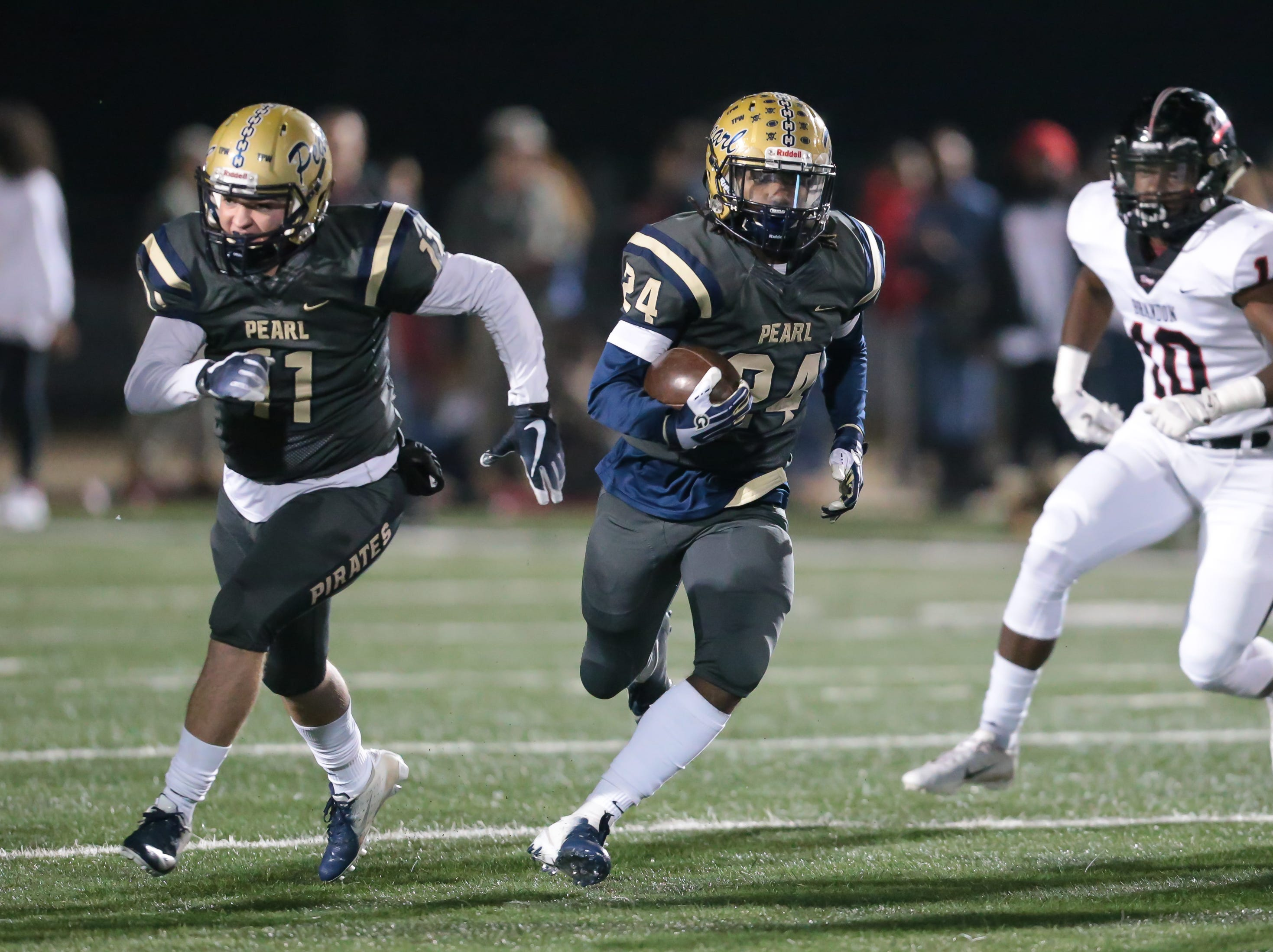 Pearl High School's Jerry Johnson (24) picks up yardage on a run in the first quarter. Pearl played Brandon High School in an MHSAA Class 6A playoff game on Friday, November 16, 2018 at Brandon. Photo by Keith Warren