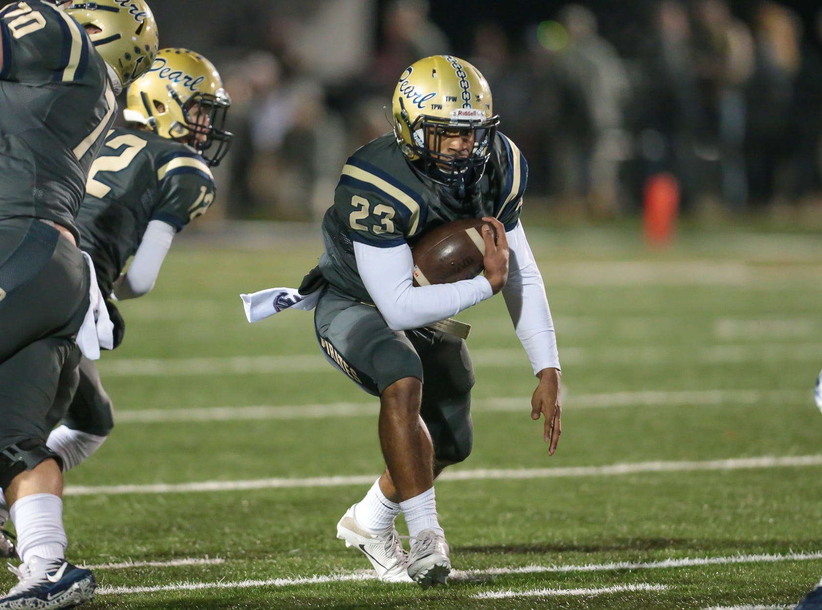 Pearl High School's Kenyatta Harrell (23) finds a hole in the Brandon defensive line in the first half. Pearl played Brandon High School in an MHSAA Class 6A playoff game on Friday, November 16, 2018 at Brandon. Photo by Keith Warren