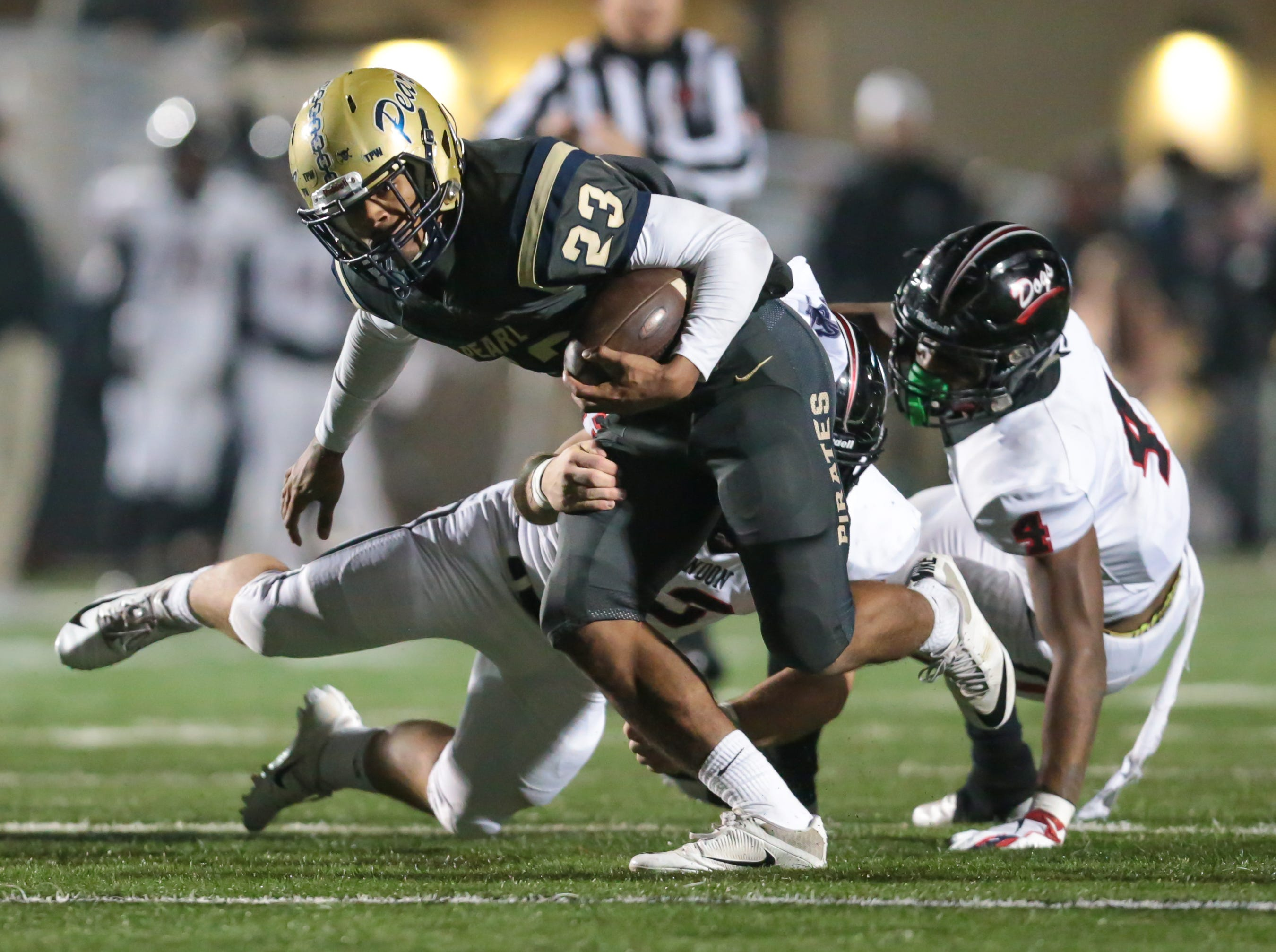 Pearl High School's Kenyatta Harrell (23) breaks a tackle in the third quarter. Pearl played Brandon High School in an MHSAA Class 6A playoff game on Friday, November 16, 2018 at Brandon. Photo by Keith Warren