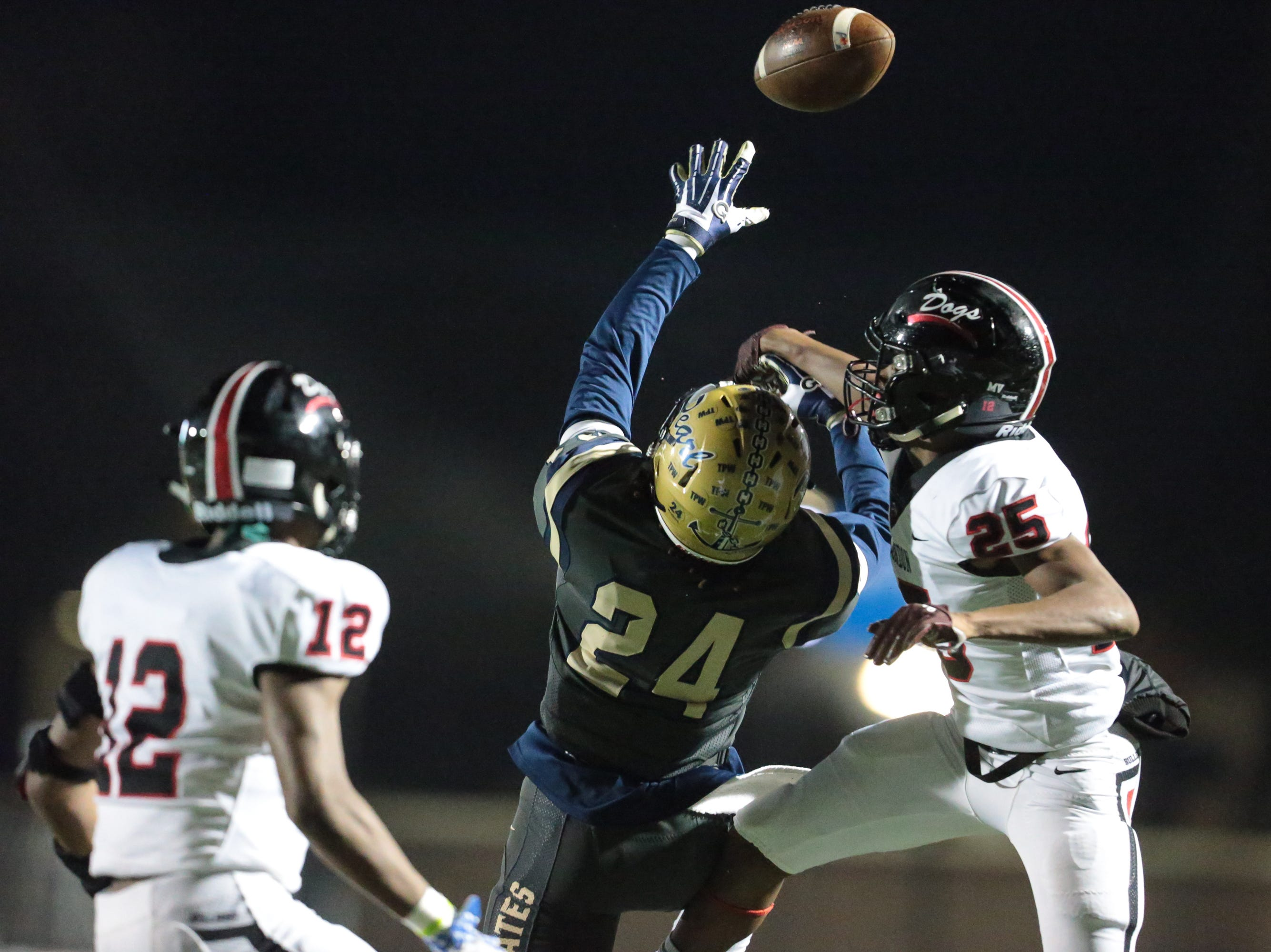 Brandon High School's Richard O'Bryant III (25) breaks up a pass intended for Pearl High School's Jerry Johnson (24). Pearl played Brandon High School in an MHSAA Class 6A playoff game on Friday, November 16, 2018 at Brandon. Photo by Keith Warren
