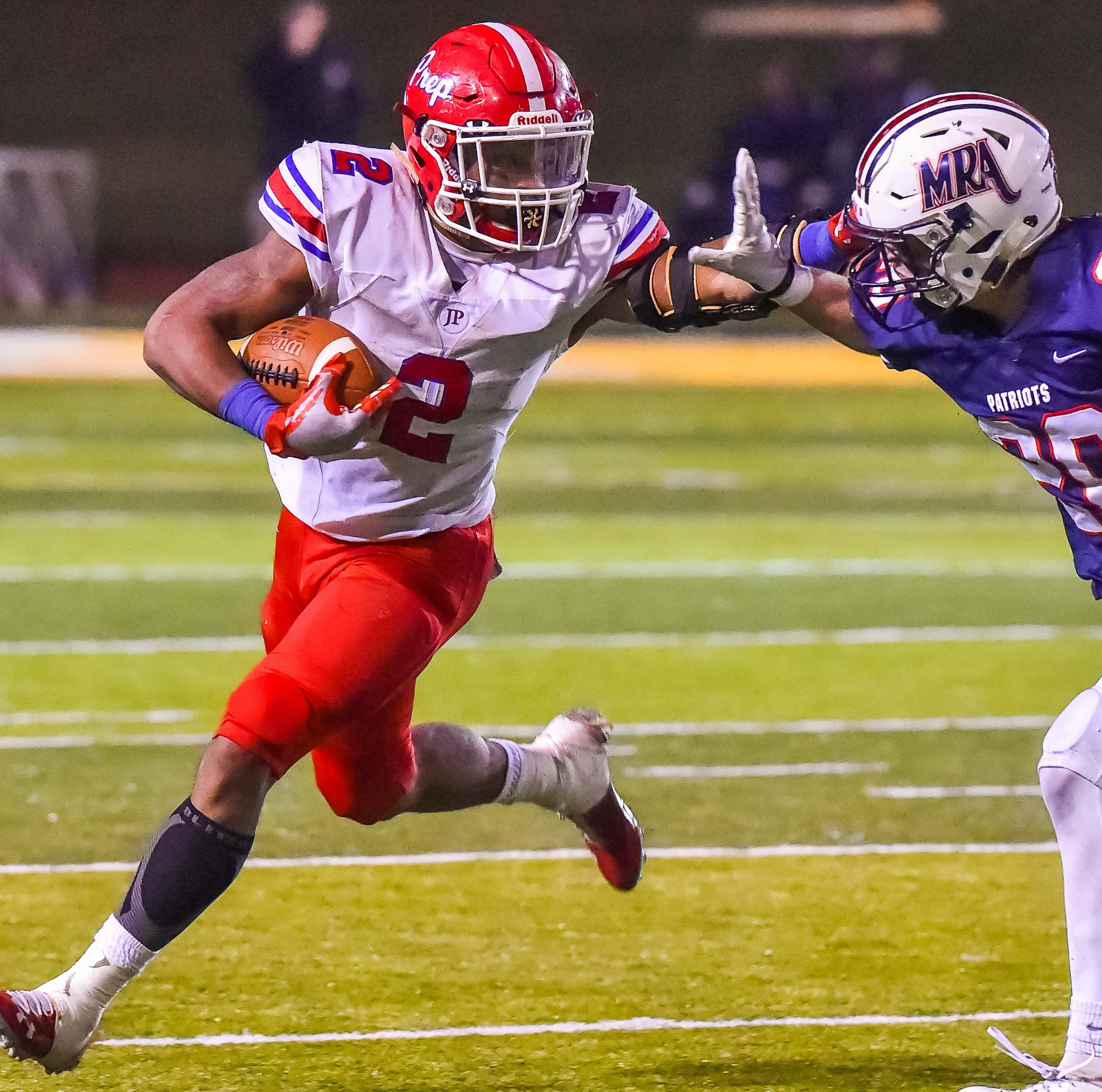 Jackson Prep's Jerrion Ealy (2) looks for running room against MRA's Hayes Puckett (20) during the MAIS Class AAAA Championship Football game held at Jackson Academy in Jackson, MS, Thursday November 16, 2018.(Bob Smith-For The Clarion Ledger)