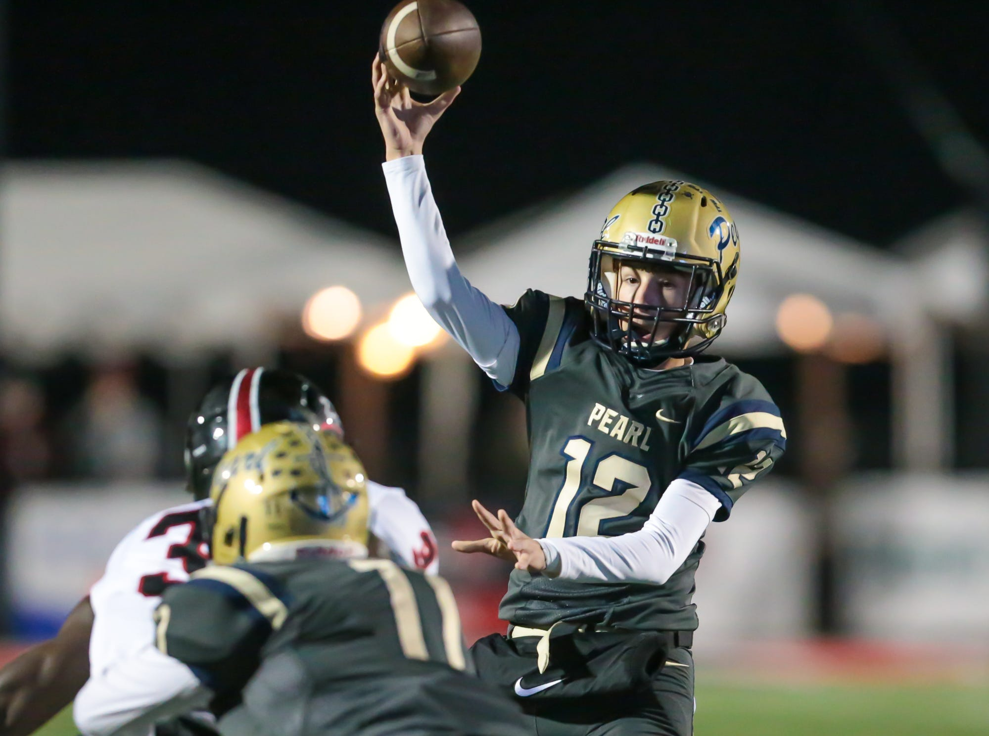 Pearl High School's Shade Foster (12) releases a pass in the first half. Pearl played Brandon High School in an MHSAA Class 6A playoff game on Friday, November 16, 2018 at Brandon. Photo by Keith Warren