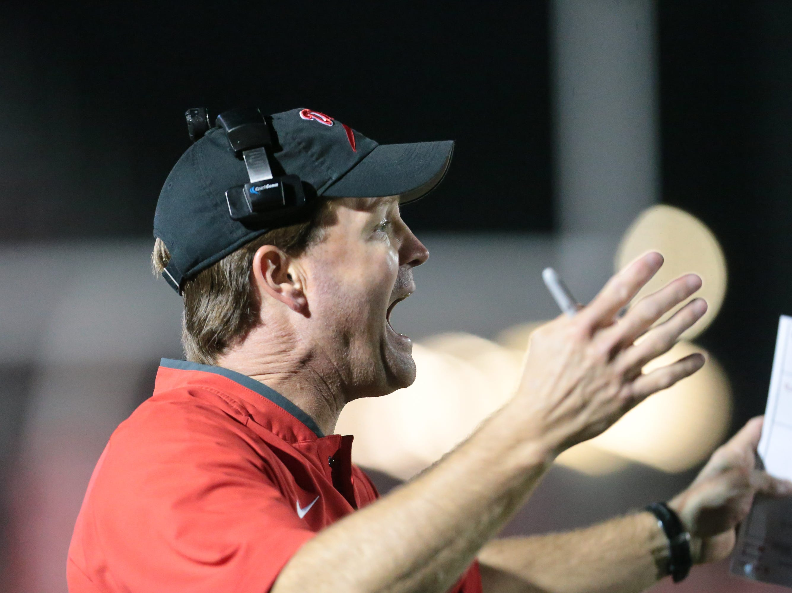 Brandon High School head football coach Tyler Peterson yells instructions to his team in the second half. Pearl played Brandon High School in an MHSAA Class 6A playoff game on Friday, November 16, 2018 at Brandon. Photo by Keith Warren