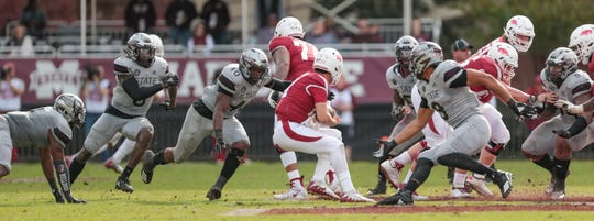 Mississippi State's Montez Sweat (9), Mississippi State's Erroll Thompson (40) and other defensive players close in on Arkansas's Connor Noland (13).  Mississippi State played Arkansas in an SEC football game on Saturday, November 17, 2018. Photo by Keith Warren