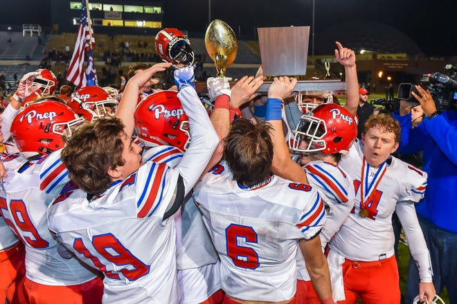 Jackson Prep players celebrate with the trophy following their 33-27 win over Madison Ridgeland Academy during the MAIS Class AAAA Championship Football game held at Jackson Academy in Jackson, MS, Thursday November 16, 2018.