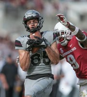 Mississippi State's Austin Williams (85) catches a touchdown pass in the second half as Arkansas's Santos Ramirez (9) defends on the play. Mississippi State played Arkansas in an SEC football game on Saturday, November 17, 2018. Photo by Keith Warren