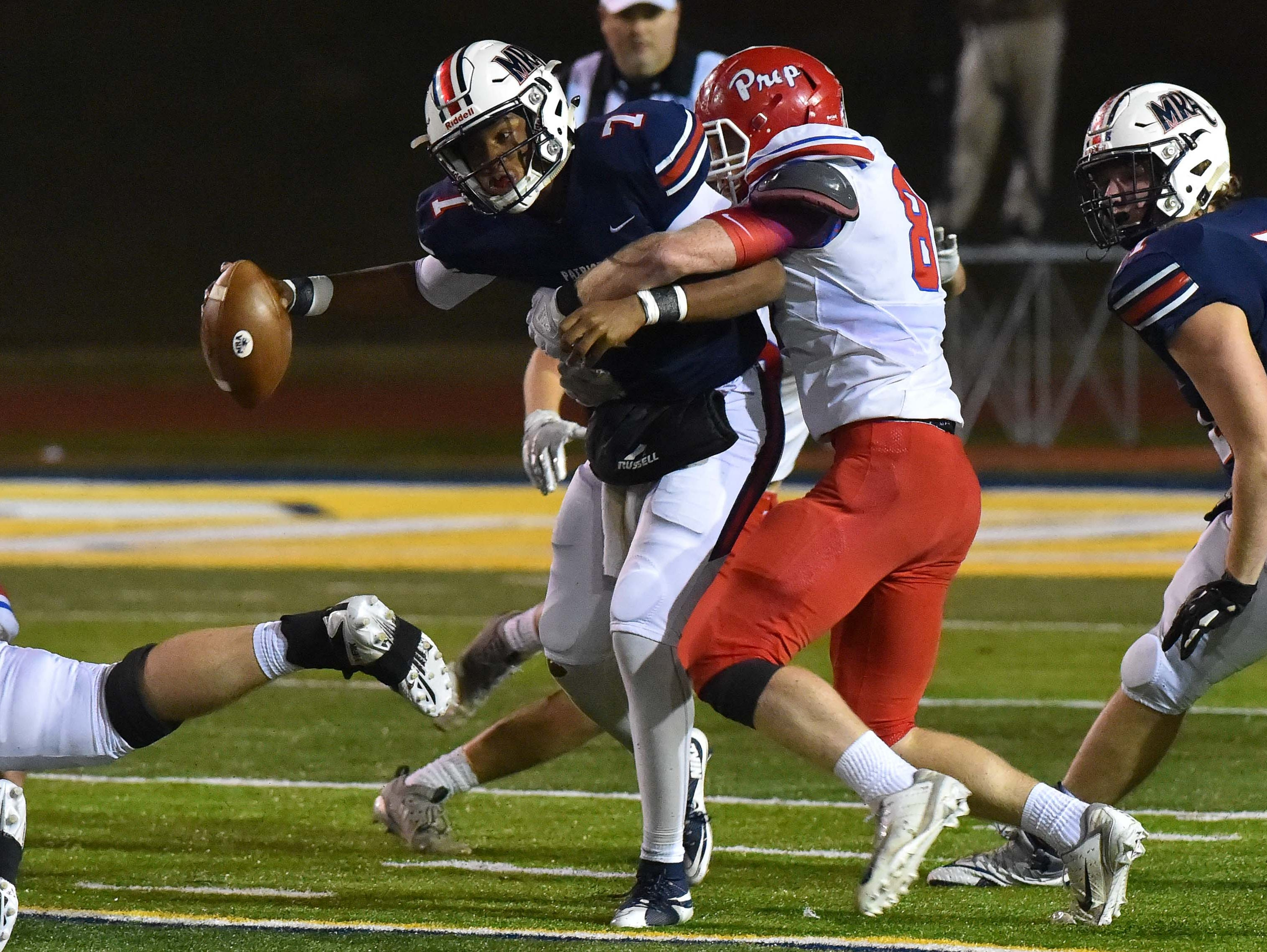 Madison Ridgeland Academy quarterback Phillip Short (7) is sacked by Jackson Prep during the MAIS Class AAAA Championship Football game held at Jackson Academy in Jackson, MS, Thursday November 16, 2018.(Bob Smith-For The Clarion Ledger)