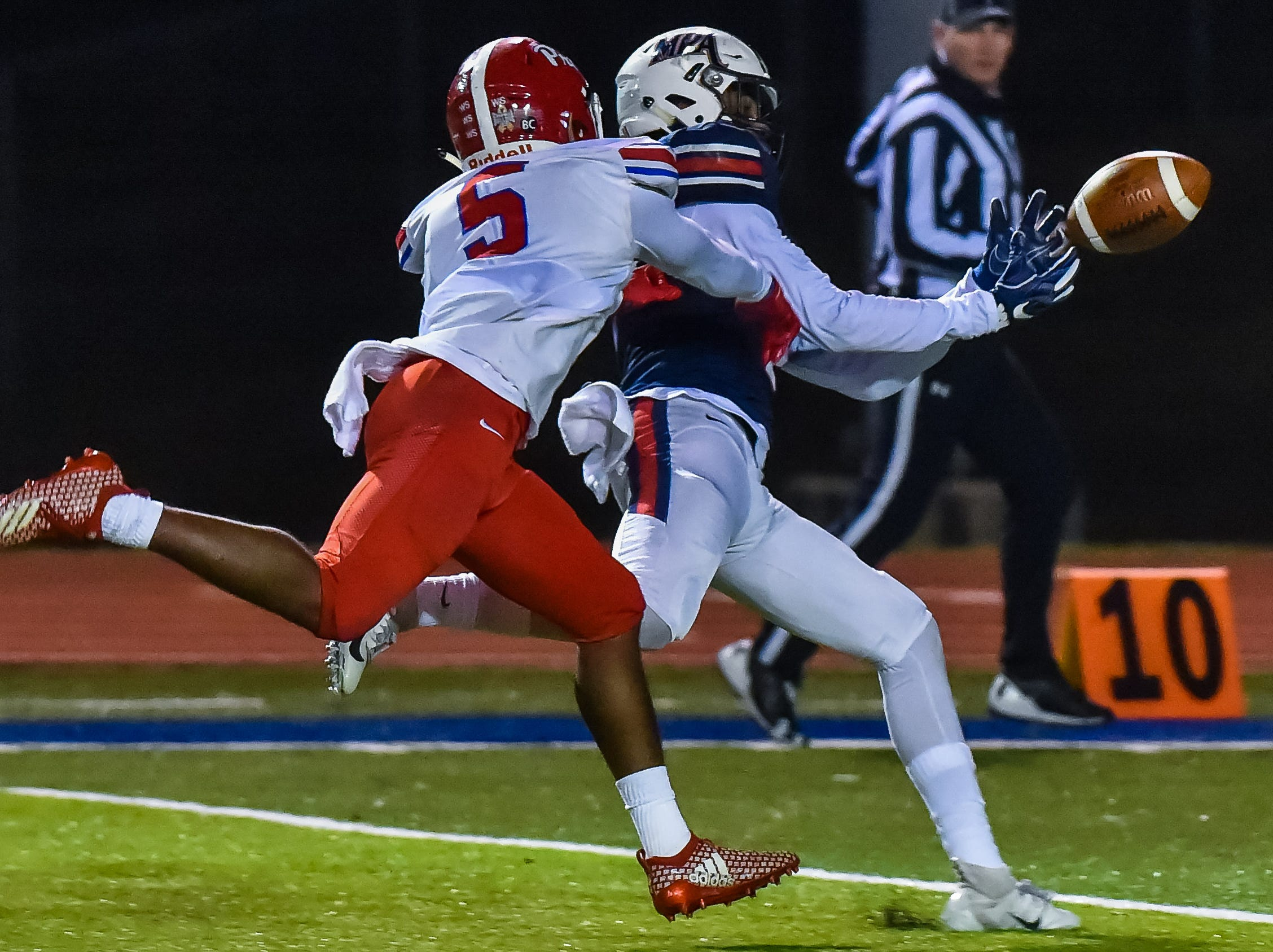 Madison Ridgeland Academy receiver Joseph Perkins can't quite haul in this pass against Jackson Prep's Matt Jones (5) during the MAIS Class AAAA Championship Football game held at Jackson Academy in Jackson, MS, Thursday November 16, 2018.(Bob Smith-For The Clarion Ledger)