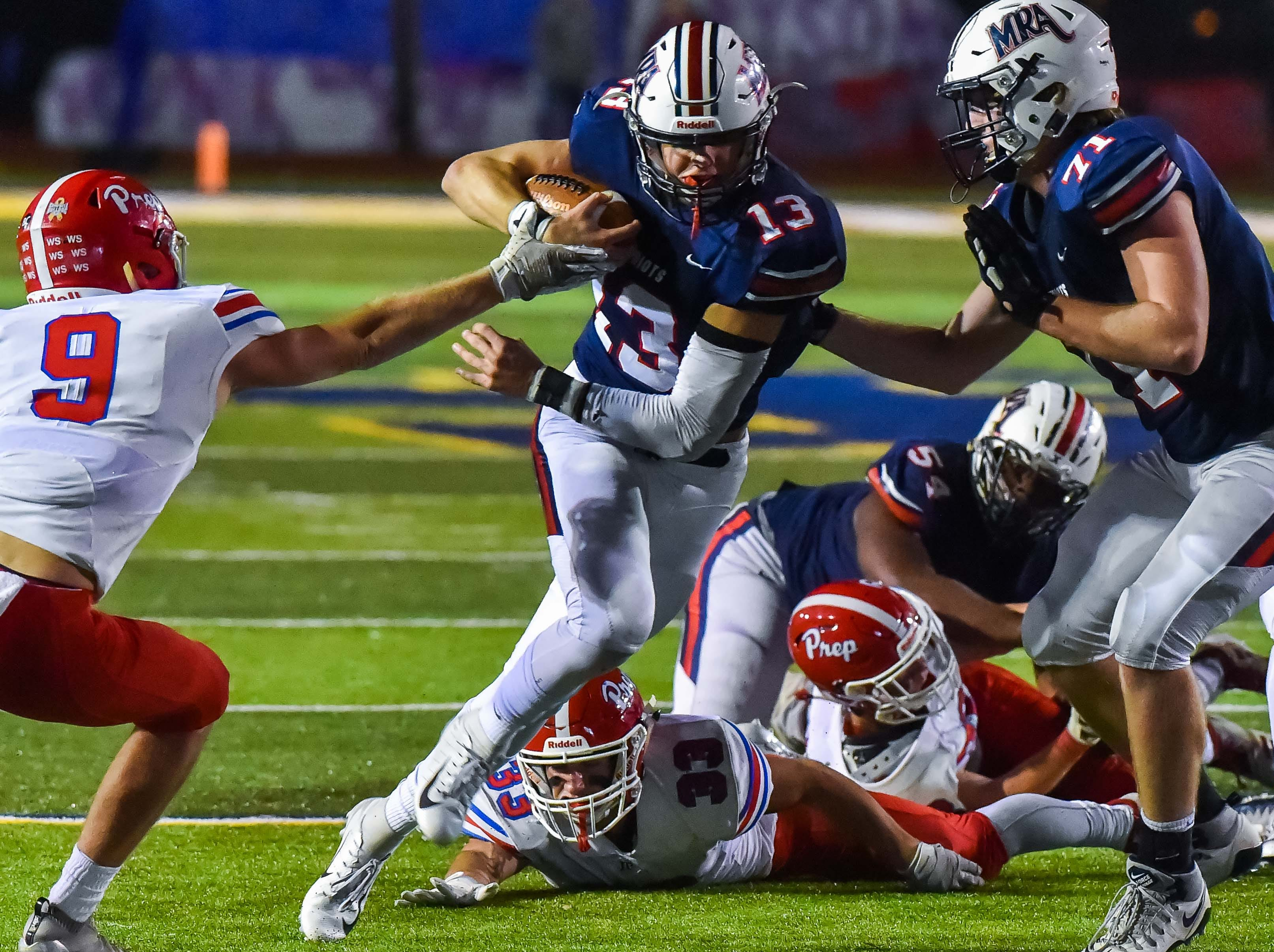 Madison Ridgeland Academy's William Milam (3) breaks a tackle on the way to a touchdown against Jackson Prep during the MAIS Class AAAA Championship Football game held at Jackson Academy in Jackson, MS, Thursday November 16, 2018.(Bob Smith-For The Clarion Ledger)