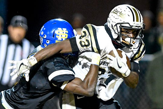 Springfield's Dayron Johnson (23) tries to brush off a North Side player during a TSSAA playoff football game between Jackson North Side and Springfield High Schools at North Side High School in Jackson, Tenn., on Friday, Nov. 16, 2018.