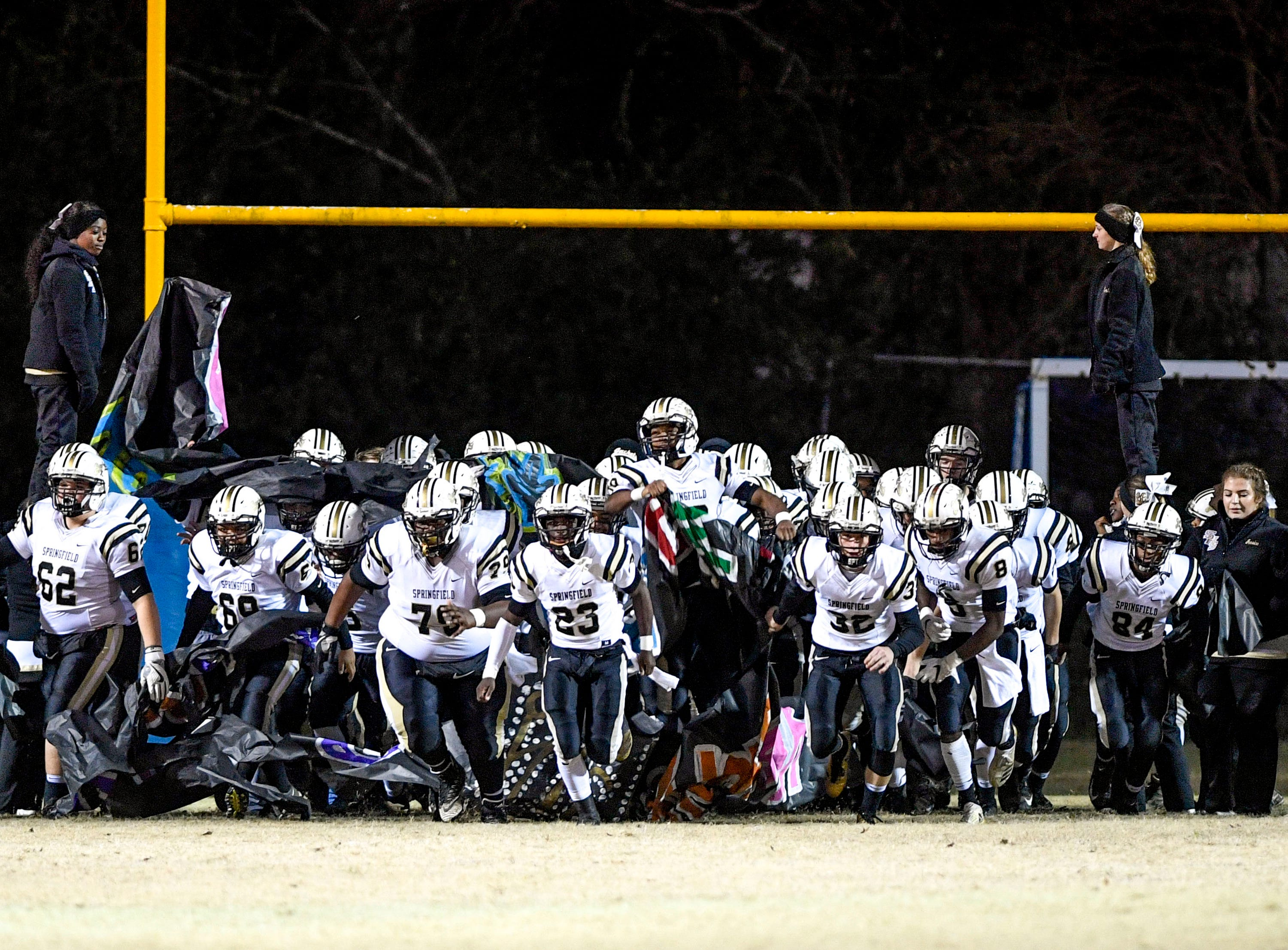 Springfield Yellowjackets enter the field tearing through a banner during a TSSAA playoff football game between Jackson North Side and Springfield High Schools at North Side High School in Jackson, Tenn., on Friday, Nov. 16, 2018.