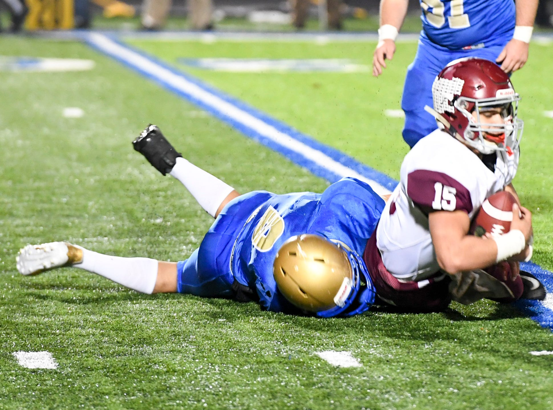 Cornersville's Cameron Whitaker is stopped by Huntingdon's Hunter Ensley during their TSSAA Class A quarter final game, Friday, November 16. Huntingdon fell to Cornersville, 13-7.