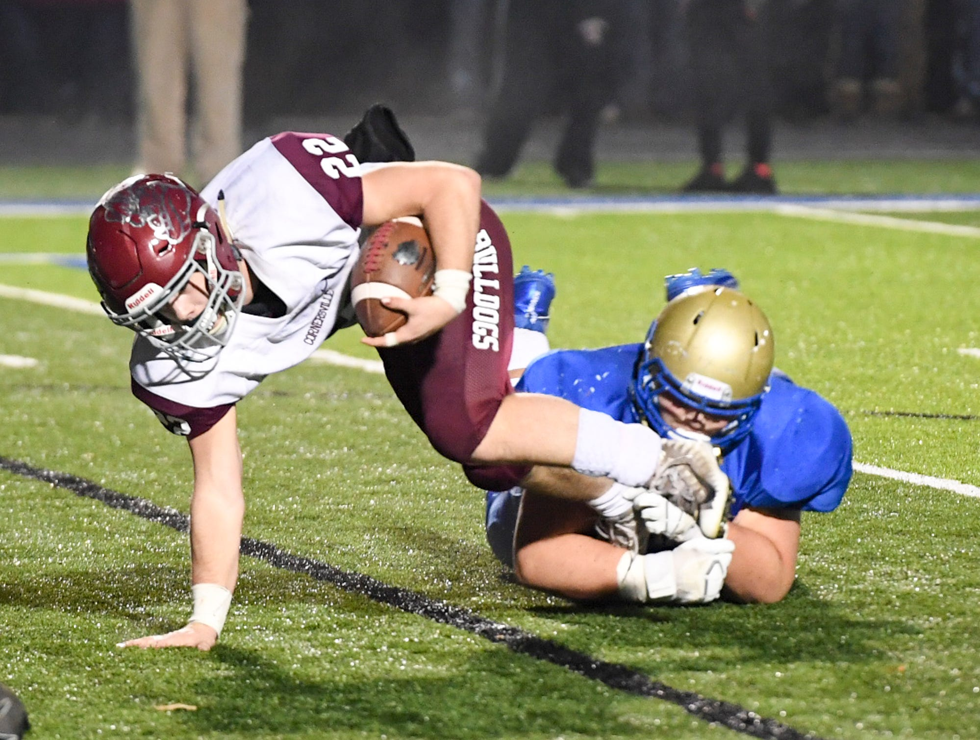 Cornersville's Eli Woodard is grabbed by a Huntingdon defender during their TSSAA Class A quarter final game, Friday, November 16. Huntingdon fell to Cornersville, 13-7.