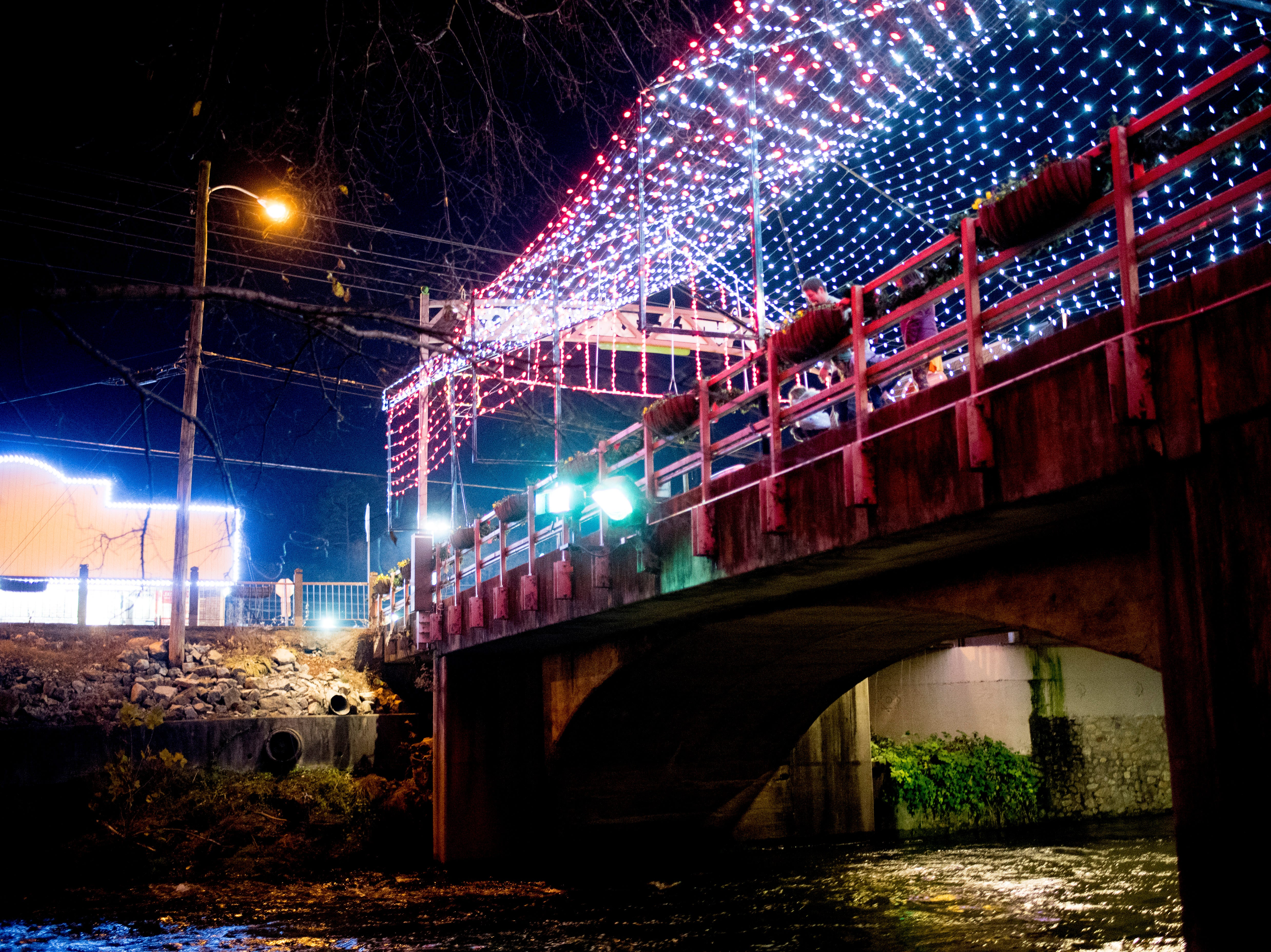 The Old Mill Bridge is covered with lights during the annual Winterfest holiday lights display in Pigeon Forge, Tennessee on Friday, November 16, 2018.