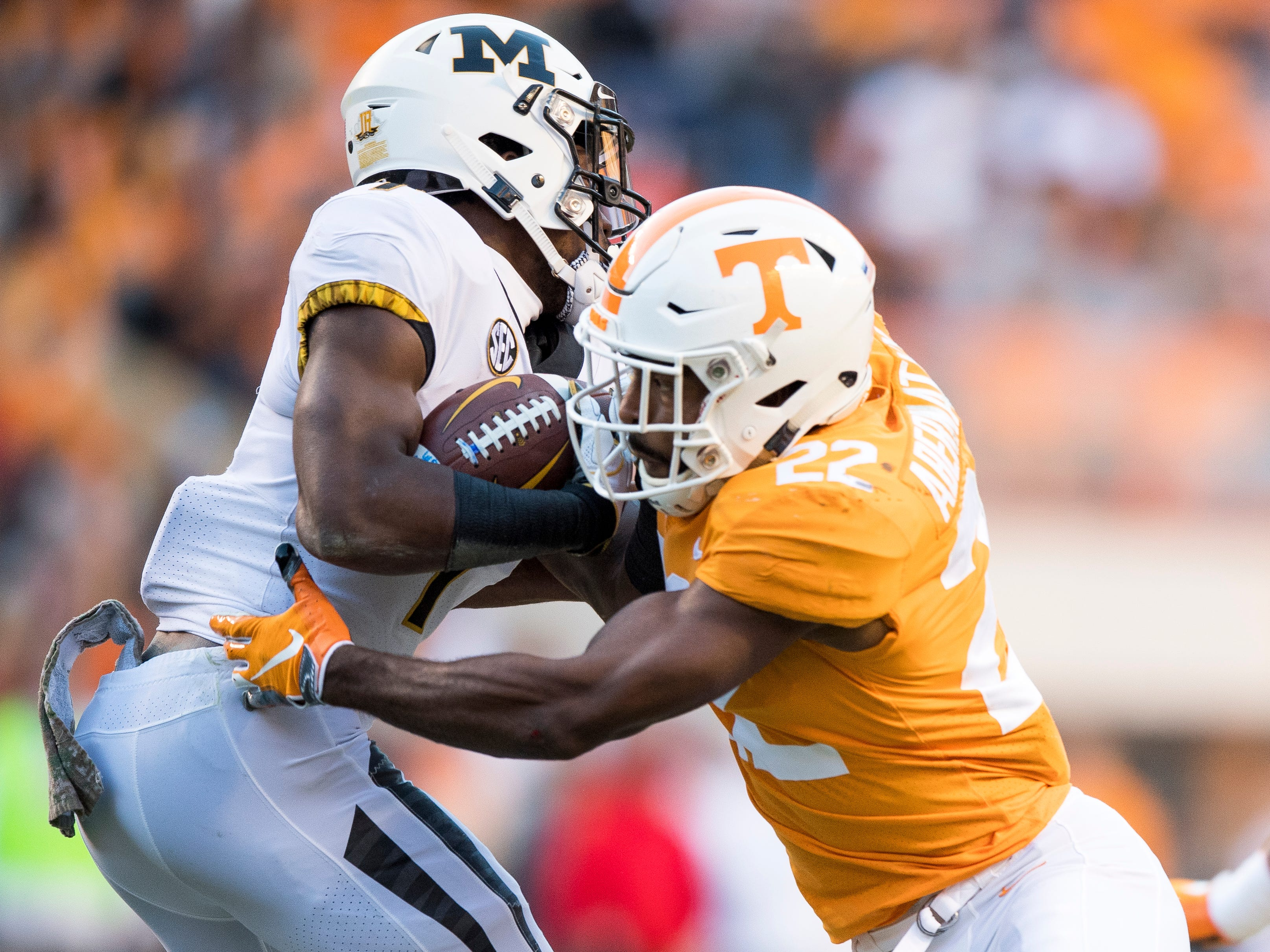 Tennessee defensive back Micah Abernathy (22) takes down Missouri running back Tyler Badie (1) during the Tennessee Volunteers game against the Missouri Tigers in Neyland Stadium on Saturday, November 17, 2018.