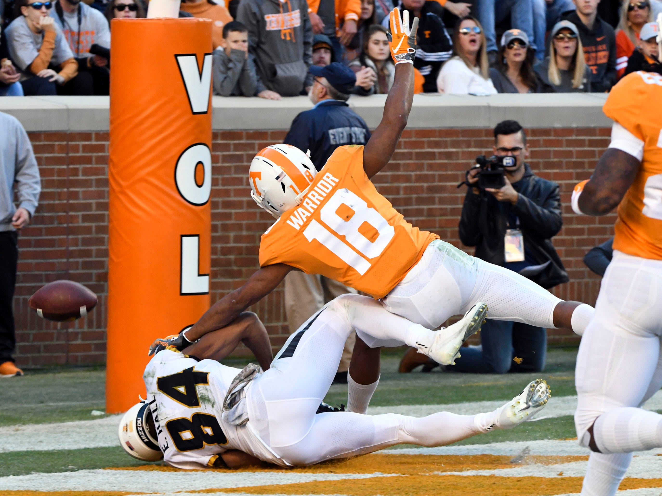 Tennessee defensive back Nigel Warrior (18) breaks up a pass intended for Missouri wide receiver Emanuel Hall (84)  during the Tennessee and Missouri football game on Saturday, November 17, 2018.