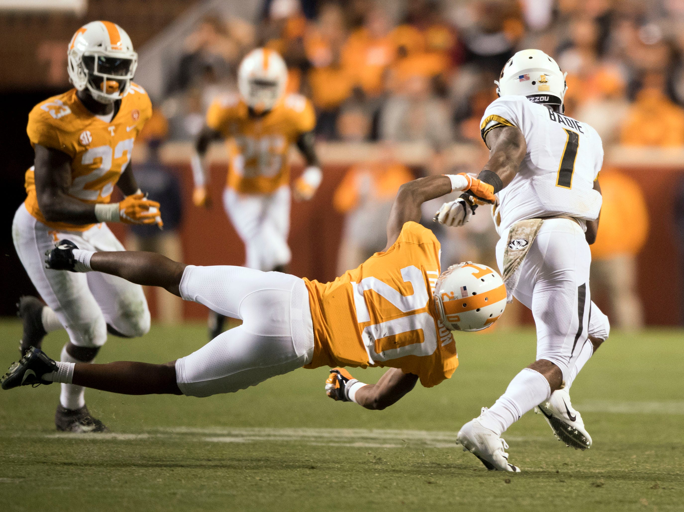 Missouri running back Tyler Badie (1) gets past Tennessee defensive back Bryce Thompson (20) during the Tennessee and Missouri football game on Saturday, November 17, 2018.