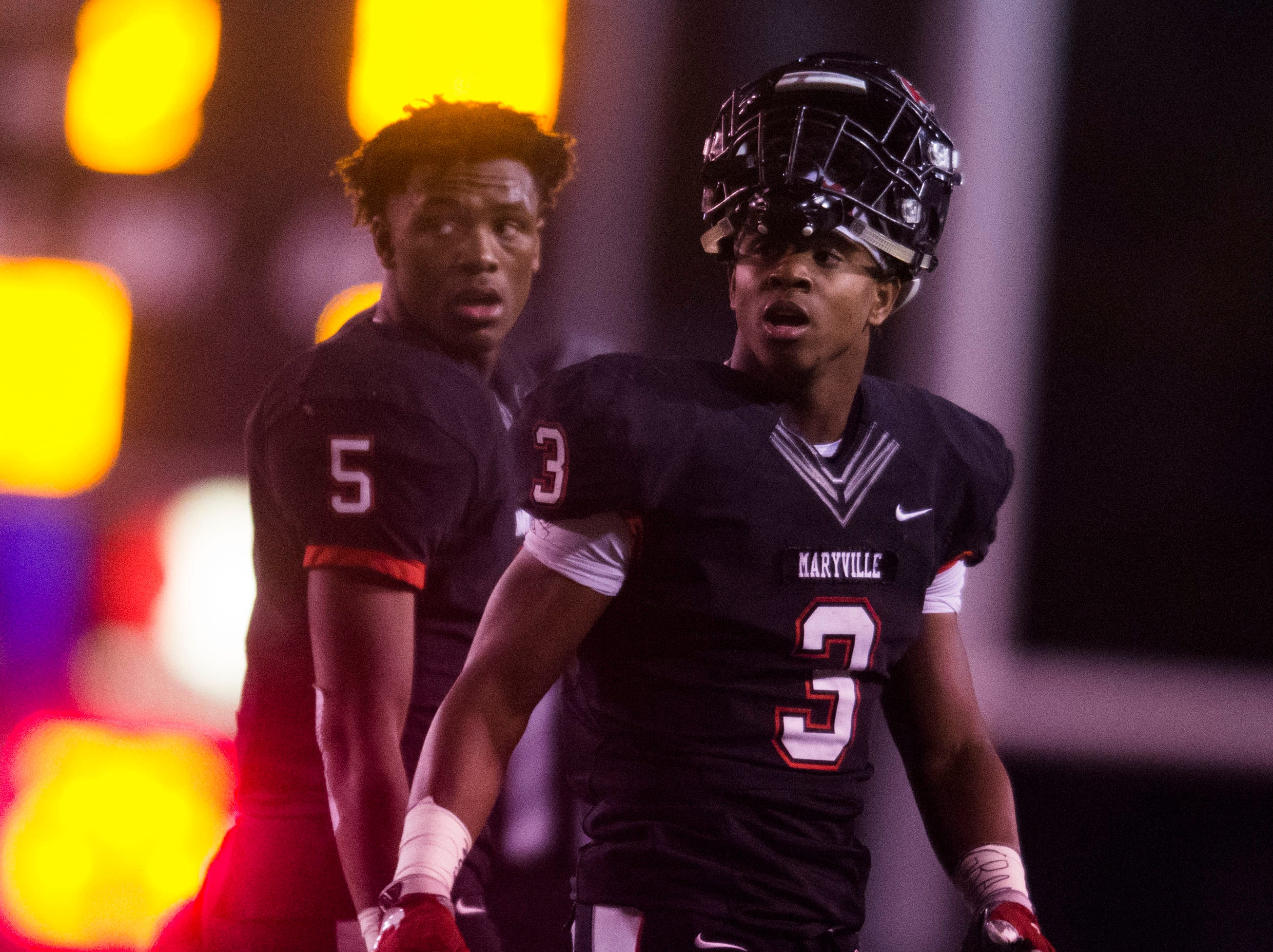 Maryville's DaVon Kimble (5) and Maryville's A.J. Davis (3) walk on the field during a 6A quarterfinal game between Maryville and Farragut at Maryville Friday, Nov. 16, 2018. Maryville defeated Farragut 26-10.