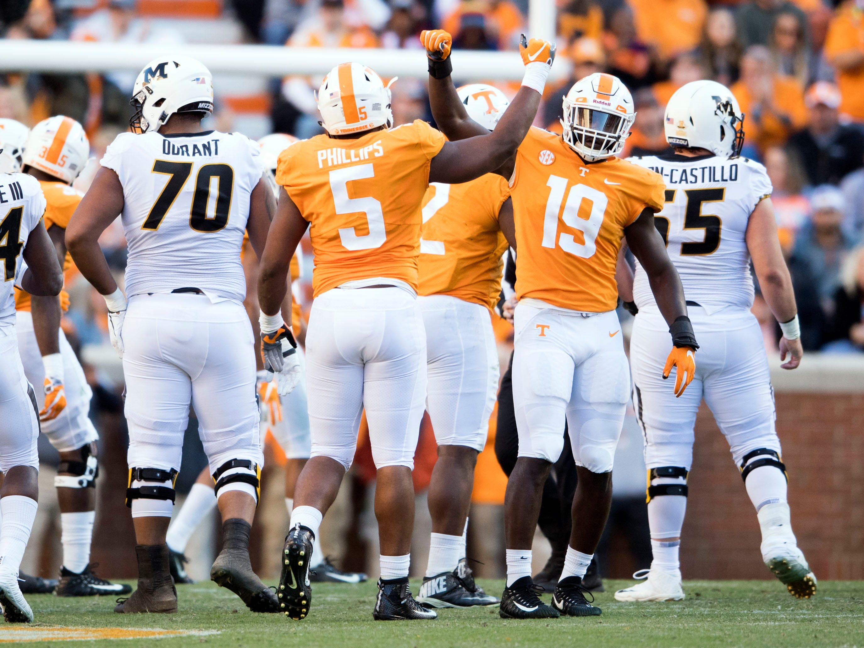 Tennessee defensive lineman Kyle Phillips (5) and linebacker Darrell Taylor (19) celebrate after making a stop against on Missouri on Saturday, November 17, 2018.