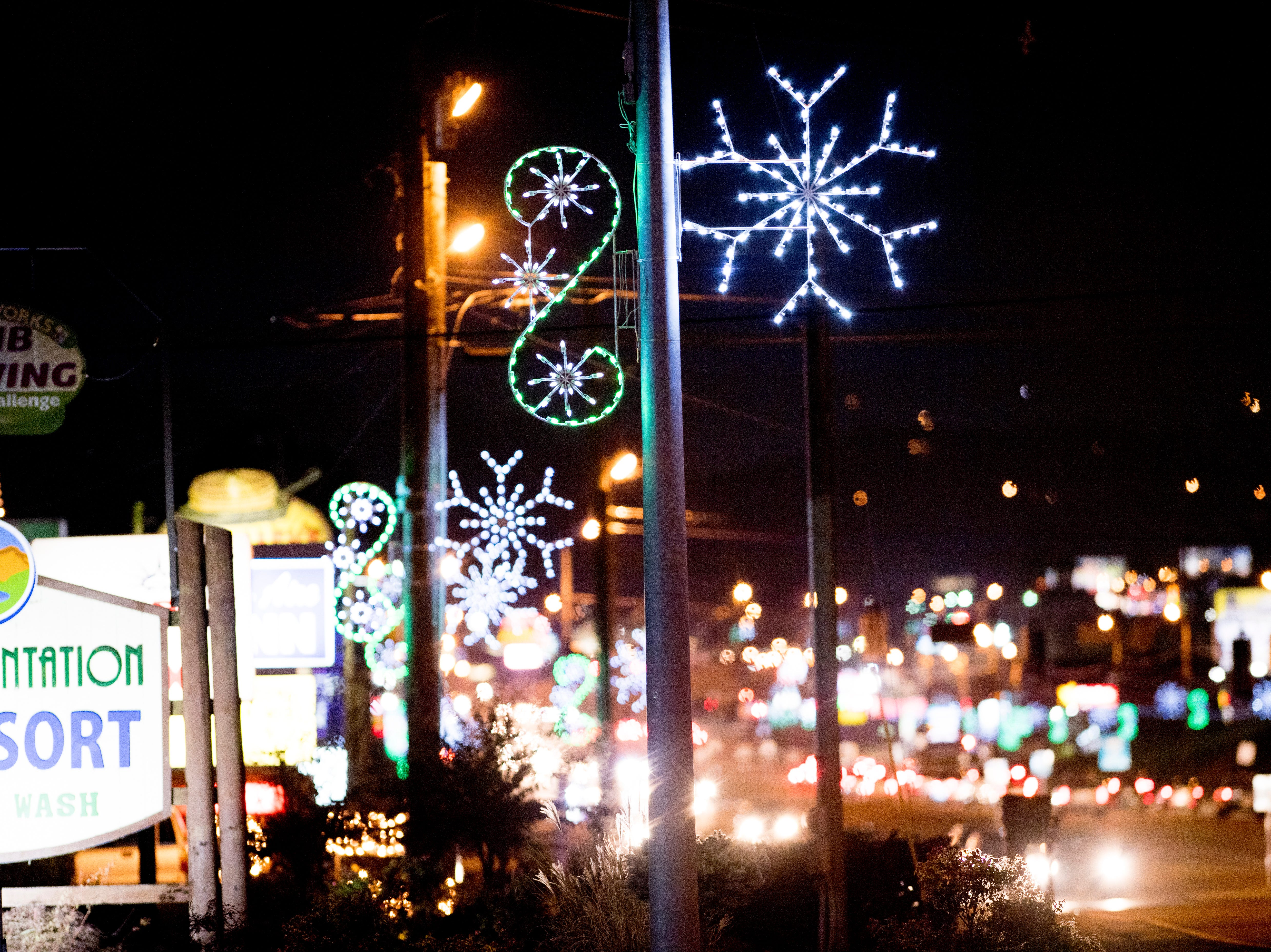 Snowflake lighting fixtures can be seen all along the Parkway in Pigeon Forge, Tennessee on Friday, November 16, 2018.