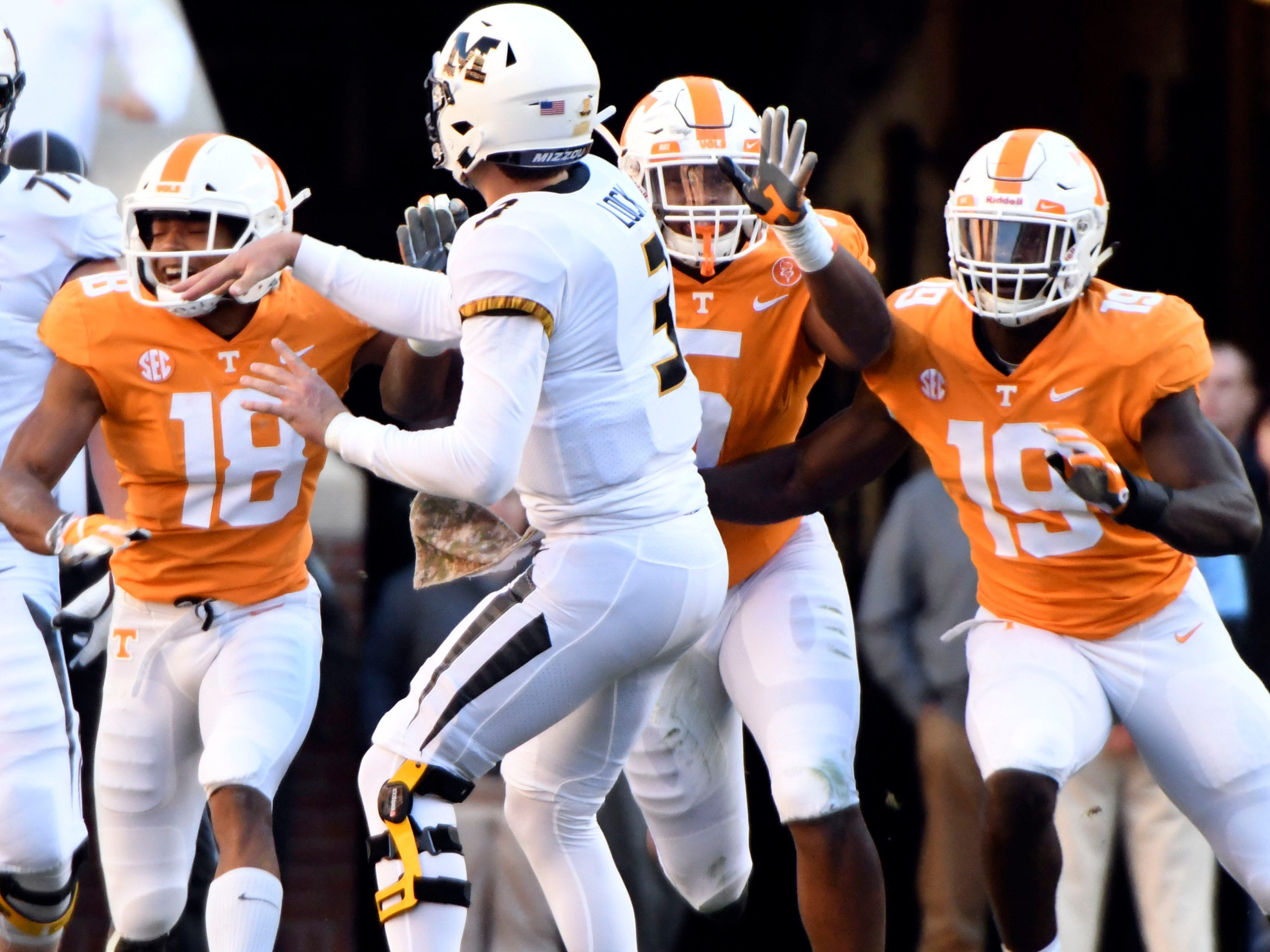 Missouri quarterback Drew Lock (3) releases the ball as he is approached by Tennessee defensive backs Nigel Warrior (18), Alontae Taylor (6), and linebacker Darrell Taylor (19)   during the Tennessee and Missouri football game on Saturday, November 17, 2018.
