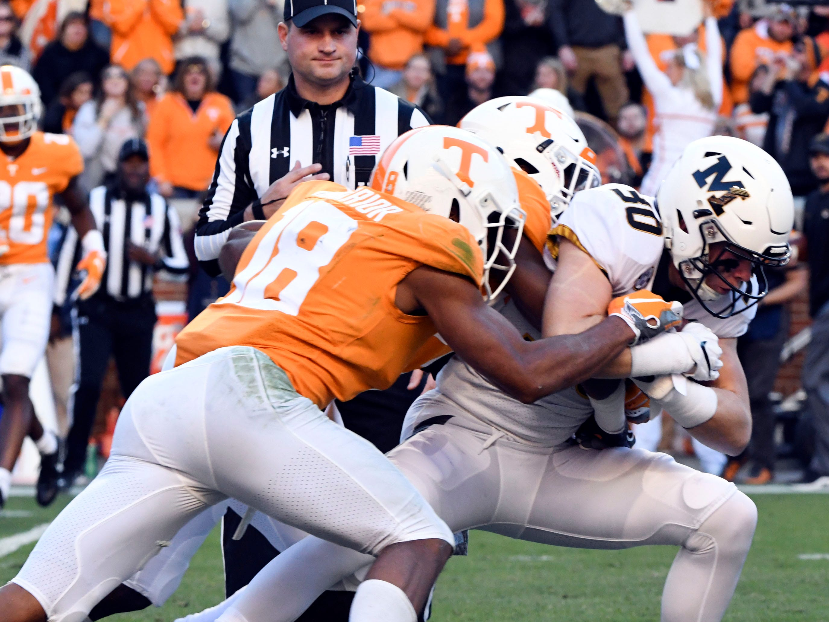 Tennessee defensive back Nigel Warrior (18) and linebacker Austin Smith (30) put a stop to  Missouri wide receiver Barrett Banister (30) during the Tennessee and Missouri football game on Saturday, November 17, 2018.