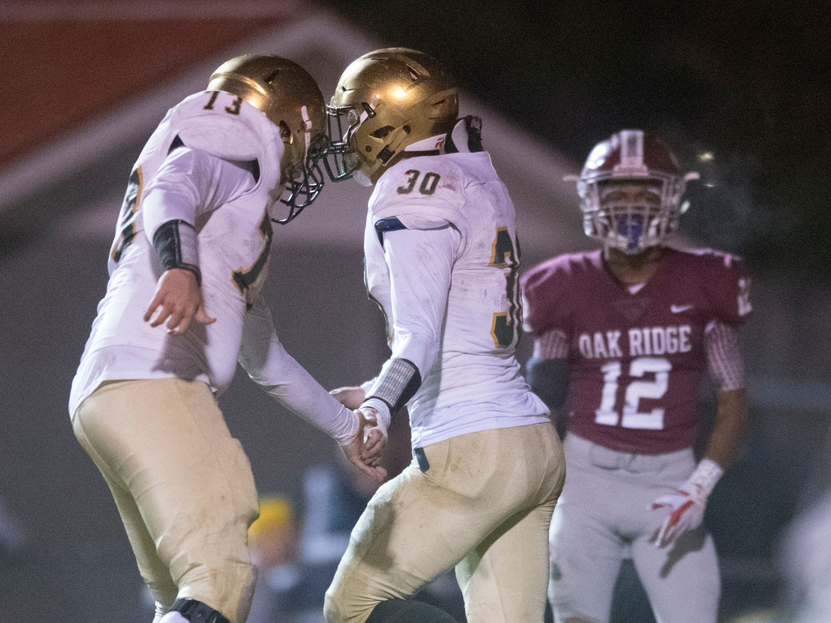Knoxville Catholic's Ray Thompson (13) and Cody Duncan (30) celebrate after Duncan scored a touchdown. Knoxville Catholic defeats Oak Ridge, 42-40 in the 5A quarterfinals on Friday, November 16, 2018.