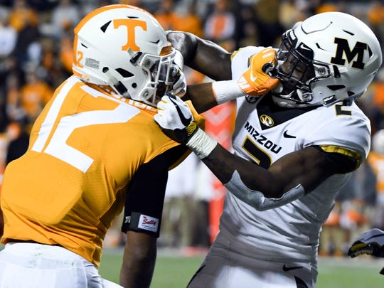 Tennessee defensive back Shawn Shamburger (12) and Missouri wide receiver Johnathon Johnson (12) get into a struggle during the Tennessee and Missouri football game on Saturday, November 17, 2018.